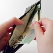 Pulling Money out of Wallet — Stock Photo #9005004