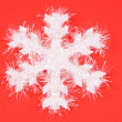Royalty-Free Stock Photo: White Snowflake on Red Background