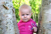 Baby Girl posing by a Tree — Stock Photo