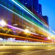 Stock Photo: Nightscape Downtown with headlights trails