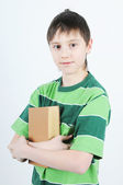 A boy holding a book — Stock Photo