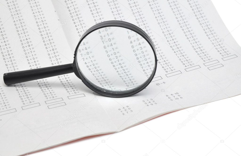 Magnifying glass on a document with columns of figures  Stock Photo #8737021