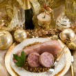 Pig trotter with lentils over golden christmas table — Stock Photo