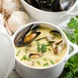 Mussel soup with saffron and cream sauce — Stock Photo