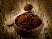Cacao powder on wood bowl — Stock Photo