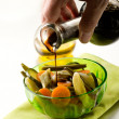 Pouring balsamic vinegar over steamed vegetables salad — Stock Photo