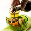 Stock Photo: Pouring balsamic vinegar over steamed vegetables salad