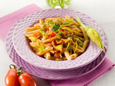Pasta with zucchinis flower and fresh tomatoes,healthy food — Stock Photo