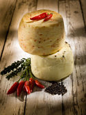 Italian cheese with hot chili pepper — Stock Photo