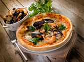Pizza with sea fruits — Stock Photo