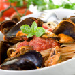 Pasta with mussel and tomato sauce — Stock Photo