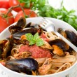 Pasta with mussel and tomato sauce - Stok fotoğraf