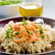 Brown rice with shrimp and arugula pesto - Stock Photo