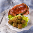 Crab meatballs with green salad - Stock Photo