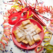 Carnival fritters on red dish - Stock Photo