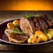 Roast of veal with potatoes — Stock Photo