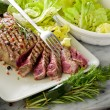Sliced steak with green salad — Stock Photo #9455733