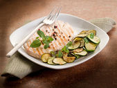 Chest of grilled chicken with zucchinis and mint leaf — Stock Photo