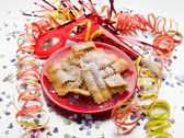Carnival fritters on red dish — Stock Photo