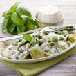 Ravioli stuffed with ricotta and basil garnish with cream and as — Stock Photo