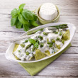 Ravioli stuffed with ricotta and basil garnish with cream and as — 图库照片