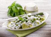 Ravioli stuffed with ricotta and basil garnish with cream and as — Foto Stock