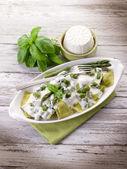 Ravioli stuffed with ricotta and basil garnish with cream and as — Stock Photo