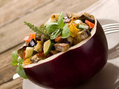 Ratatouille over open eggplant — Stock Photo
