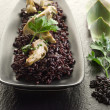Risotto with black rice and artichoke — Stock Photo
