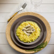 Saffron risotto with gold leaf — Stock Photo