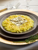 Saffron risotto with gold leaf (Gualtiero Marchesi's recipe) — Stock Photo