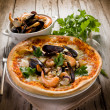 Pizza with sea fruits - Stock Photo