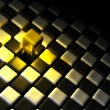 Royalty-Free Stock Photo: Golden cube alone above many black and white cubes