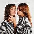 Two sailor girls in a striped vest - Stock Photo