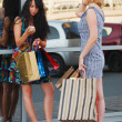Two young women with shopping bags — Foto de Stock