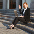 Young businesswoman using laptop - Foto Stock