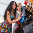 Royalty-Free Stock Photo: Two young shoppers on a car parking