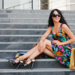 Young female shopper on the steps — Stock Photo #10708687
