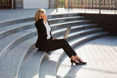 Young businesswoman using laptop — Stock Photo
