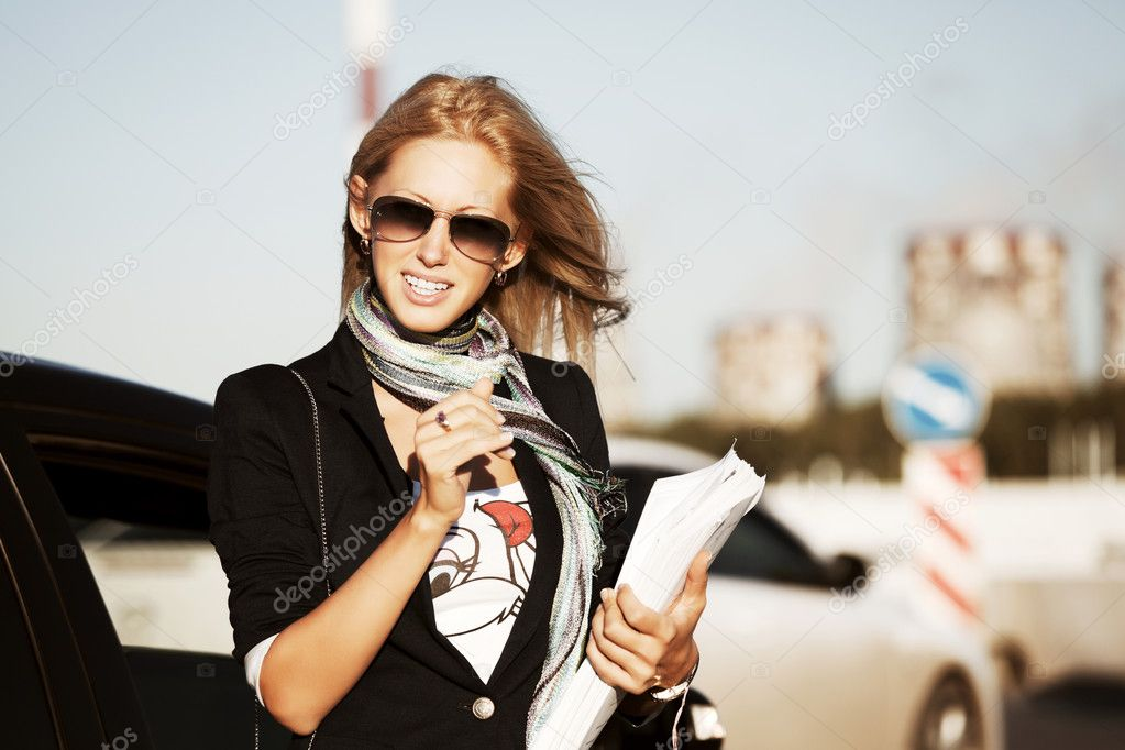 Happy businesswoman on the city street  Stock Photo #10708320