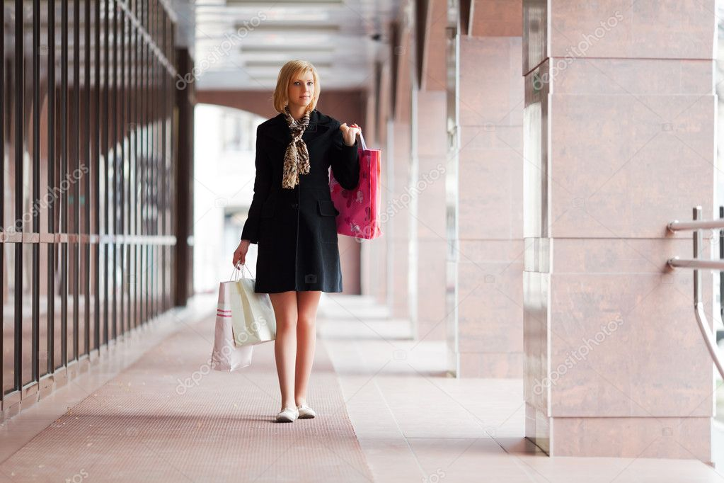 Young woman with shopping bags — Stock Photo #10708658