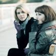 Two young women sitting on a bench — Stock Photo #8030091