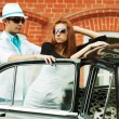 Royalty-Free Stock Photo: Young couple with a retro car
