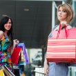 Two young women with shopping bags. — Stok fotoğraf