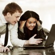 Stock Photo: Young couple with laptop