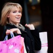 Happy young woman shopping — Stock Photo