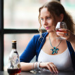 Young woman drinking a cognac — Stock Photo