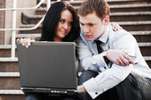 Young couple with laptop — Photo