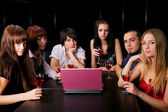Young with laptop in a bar — Stock Photo