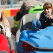 Stock Photo: Teenage girls driving bumper cars